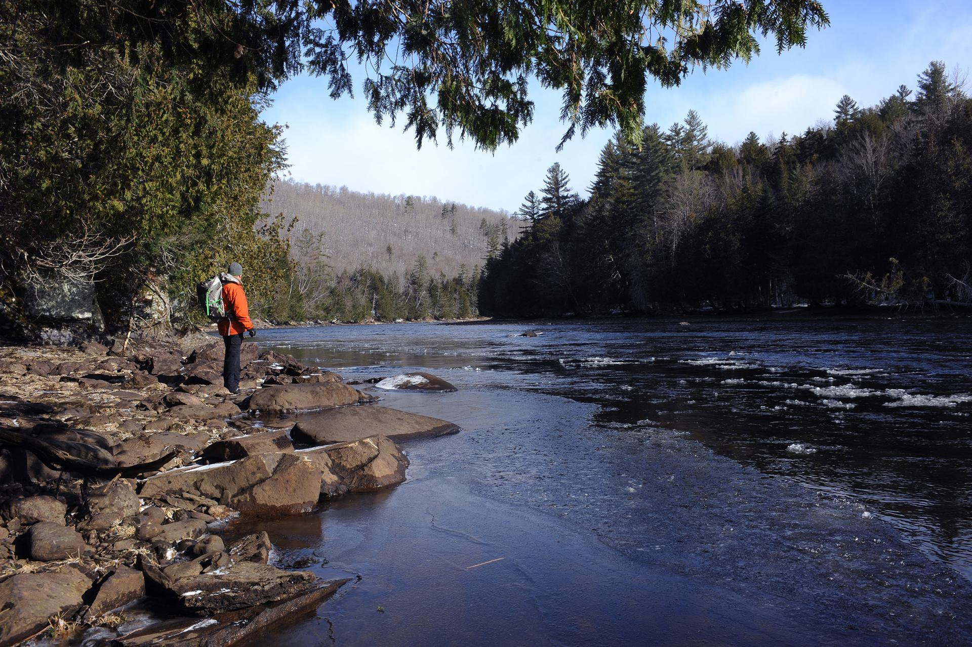 Russell Walters paused by the Kennebec River. A proposed hydropower line would cross over the Kennebec River Gorge.