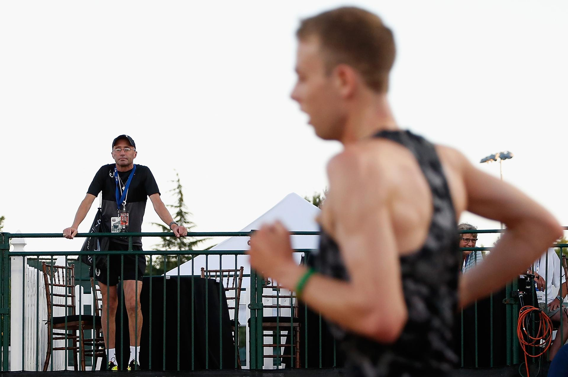 Nike Oregon Project coach Alberto Salazar (left) watched as Galen Rupp compete in the Men's 10,000 meter run during day one of the 2015 USA Outdoor Track & Field Championships at Hayward Field in 2015.