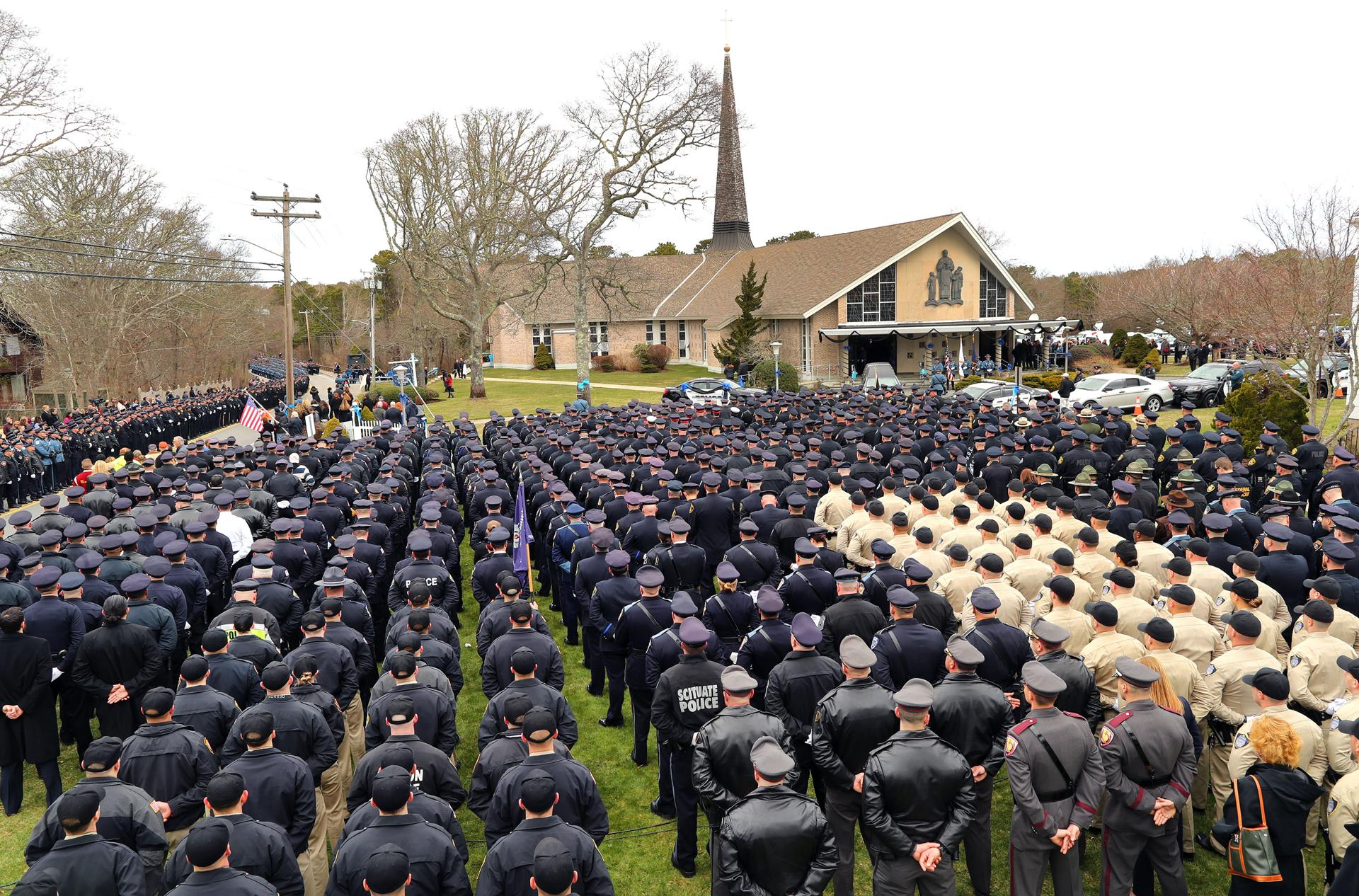 Police from all over the country stood outside the church Wednesday.