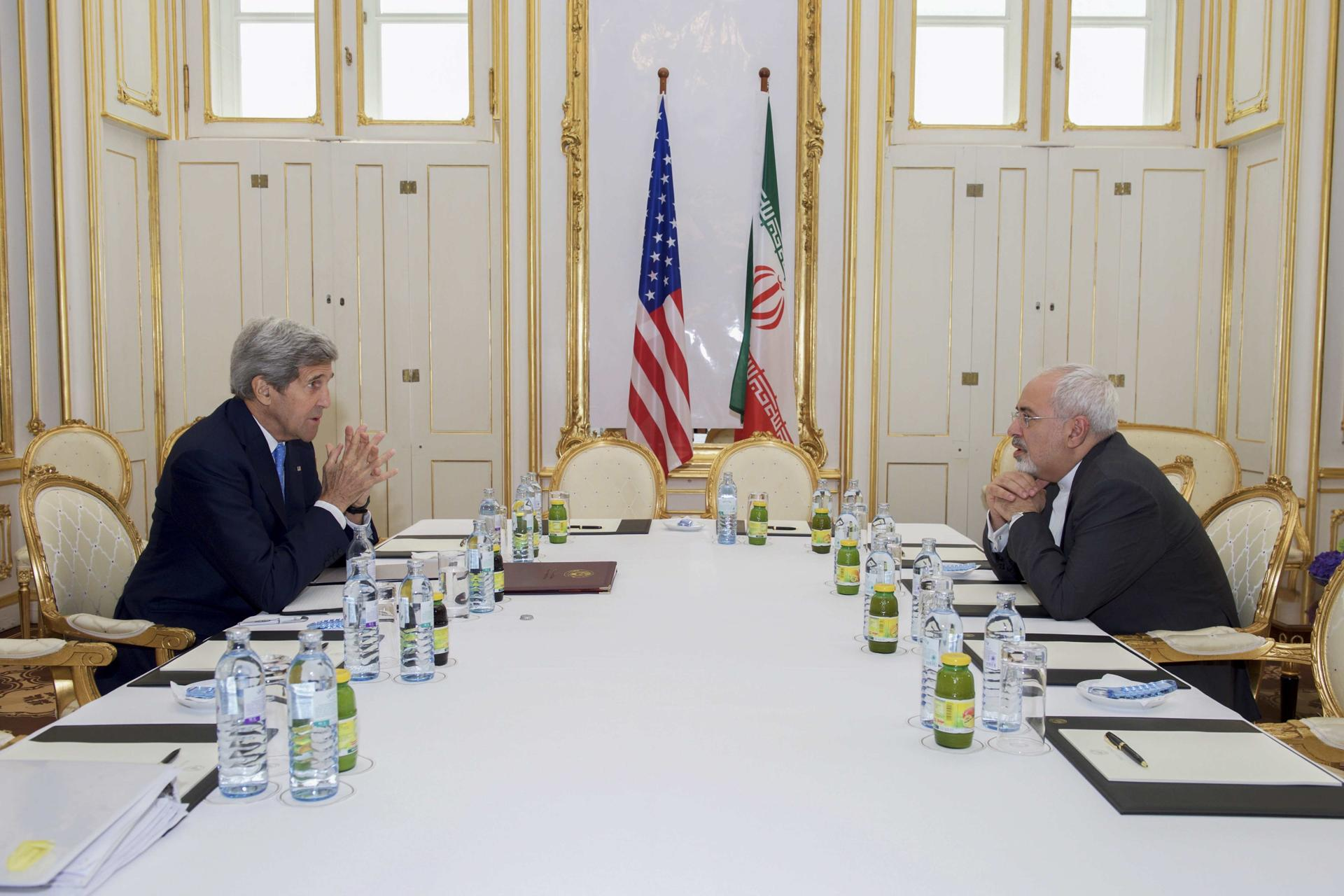 Then US Secretary of State John Kerry (left) met with Iranian Foreign Minister Javad Zarif at a hotel in Vienna, Austria June 30, 2015.