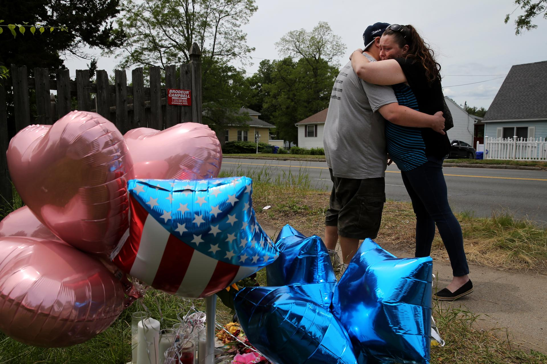 Before kidnapping charges stewart weldon cast a long shadow in a couple embraced after leaving balloons at a memorial outside the home of stewart weldon fandeluxe Choice Image