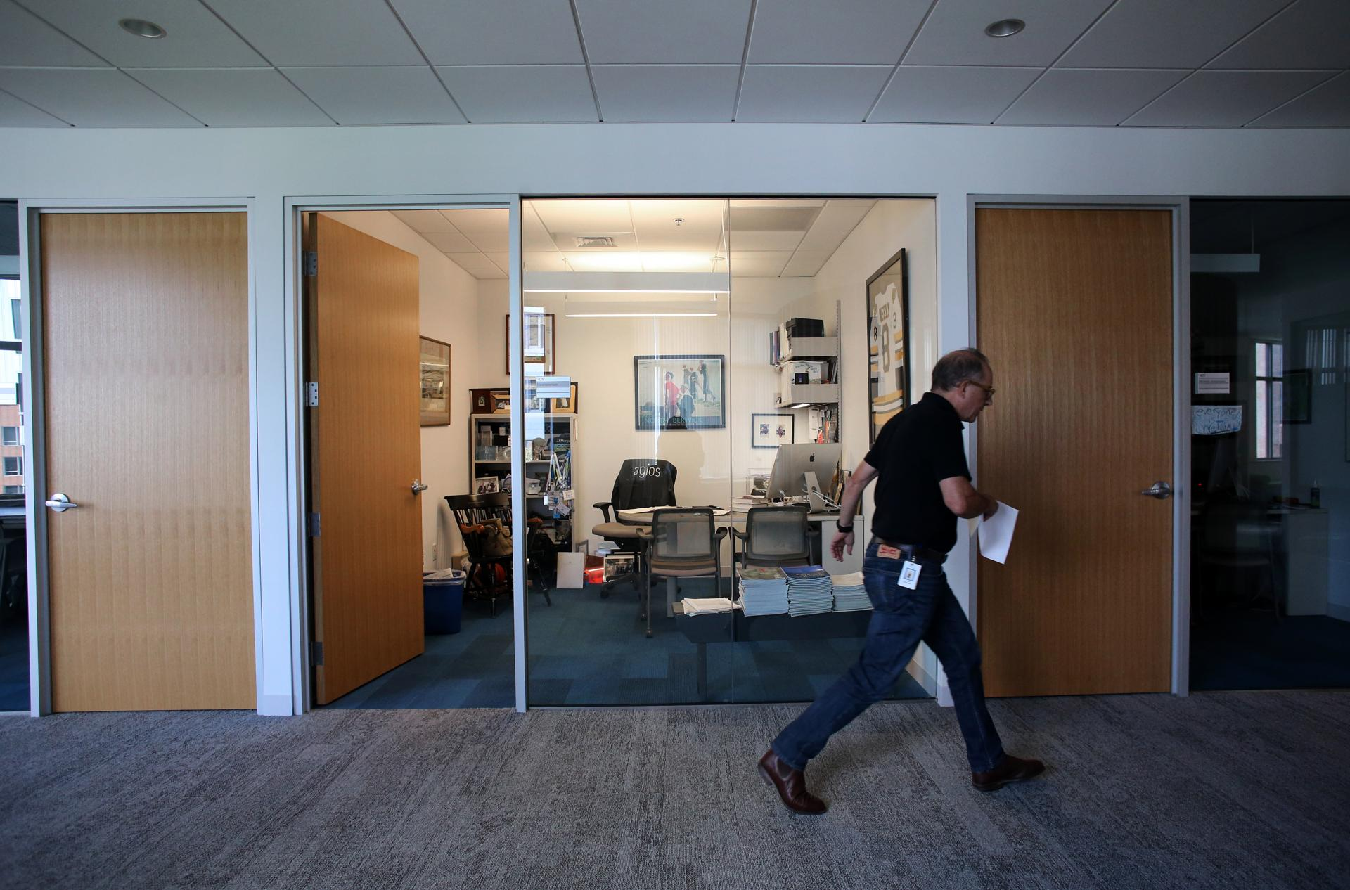 Cambridge, MA - July 10, 2018: CEO David Schenkein passes his office at Agios Pharmaceuticals Inc. in Cambridge, MA on July 10, 2018. (Craig F. Walker/Globe Staff) section: business reporter:
