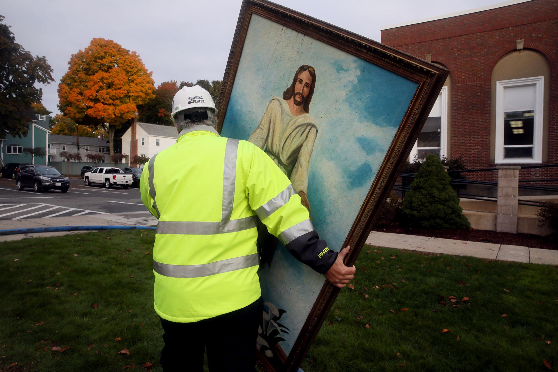Building Inspector Jack Roberto Carried A Painting Of Jesus From The First Baptist Church After Fire