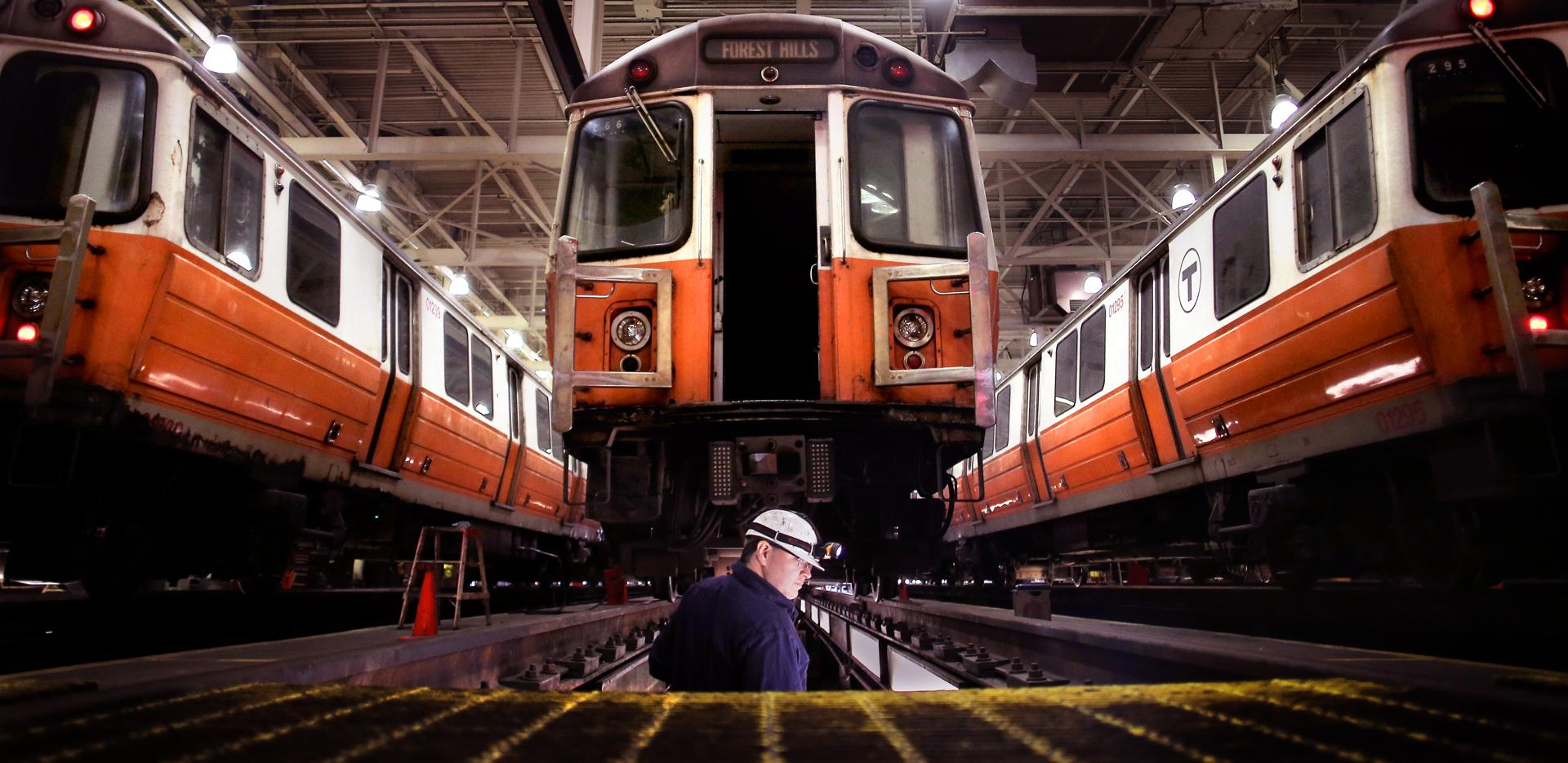 Repairer Jeff Parolisi descended stairs to a maintenance bay underneath an Orange Line car.