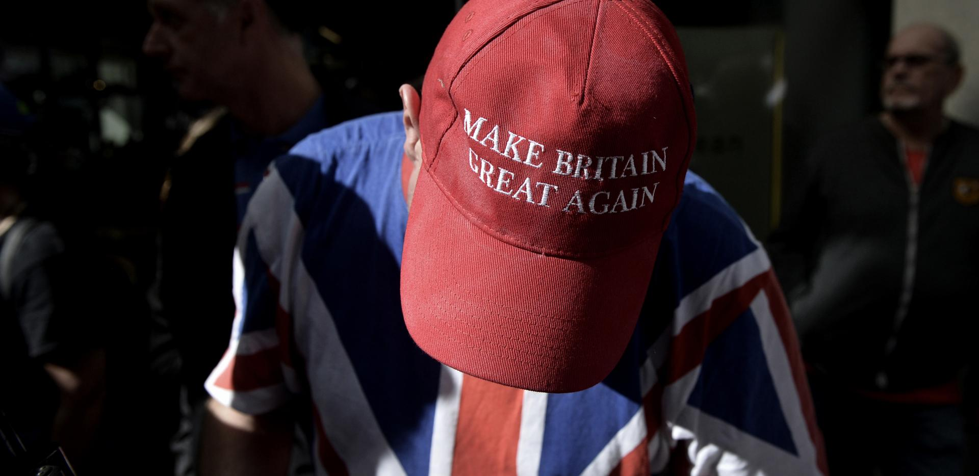 Chris, a supporter of far-right activist Tommy Robinson, wore a Make Britain Great Again cap at a rally.
