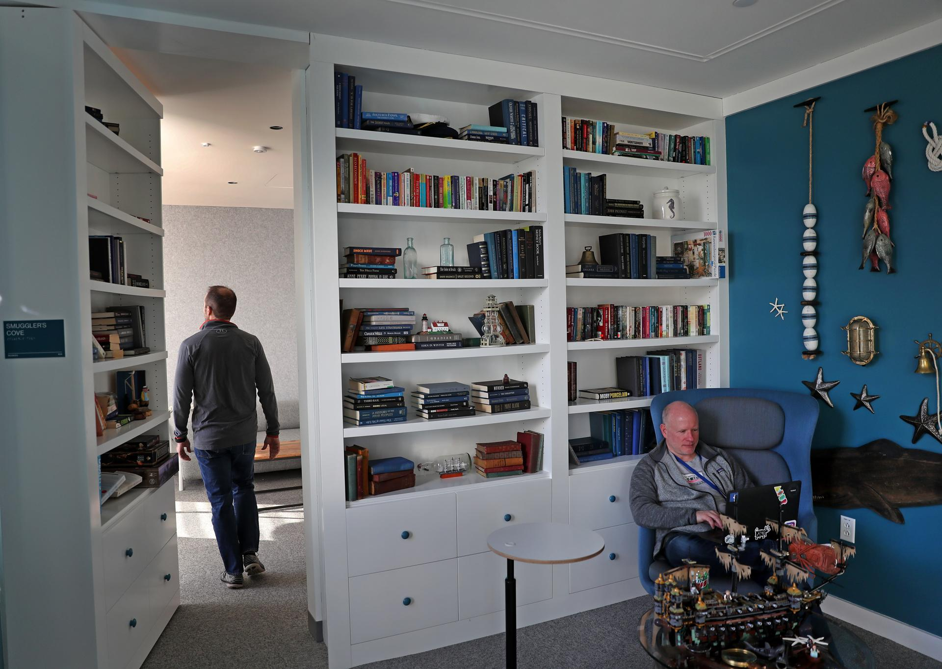 CAMBRIDGE, MA - 1/07/2019: Facebook's library with a bookcase wall that opens into a private or quiet room in the Cambridge site. Facebook preparing to open a large office in Kendall Square with space for hundreds of additional workers. (David L Ryan/Globe Staff ) SECTION: BUSINESS TOPIC 09facebook
