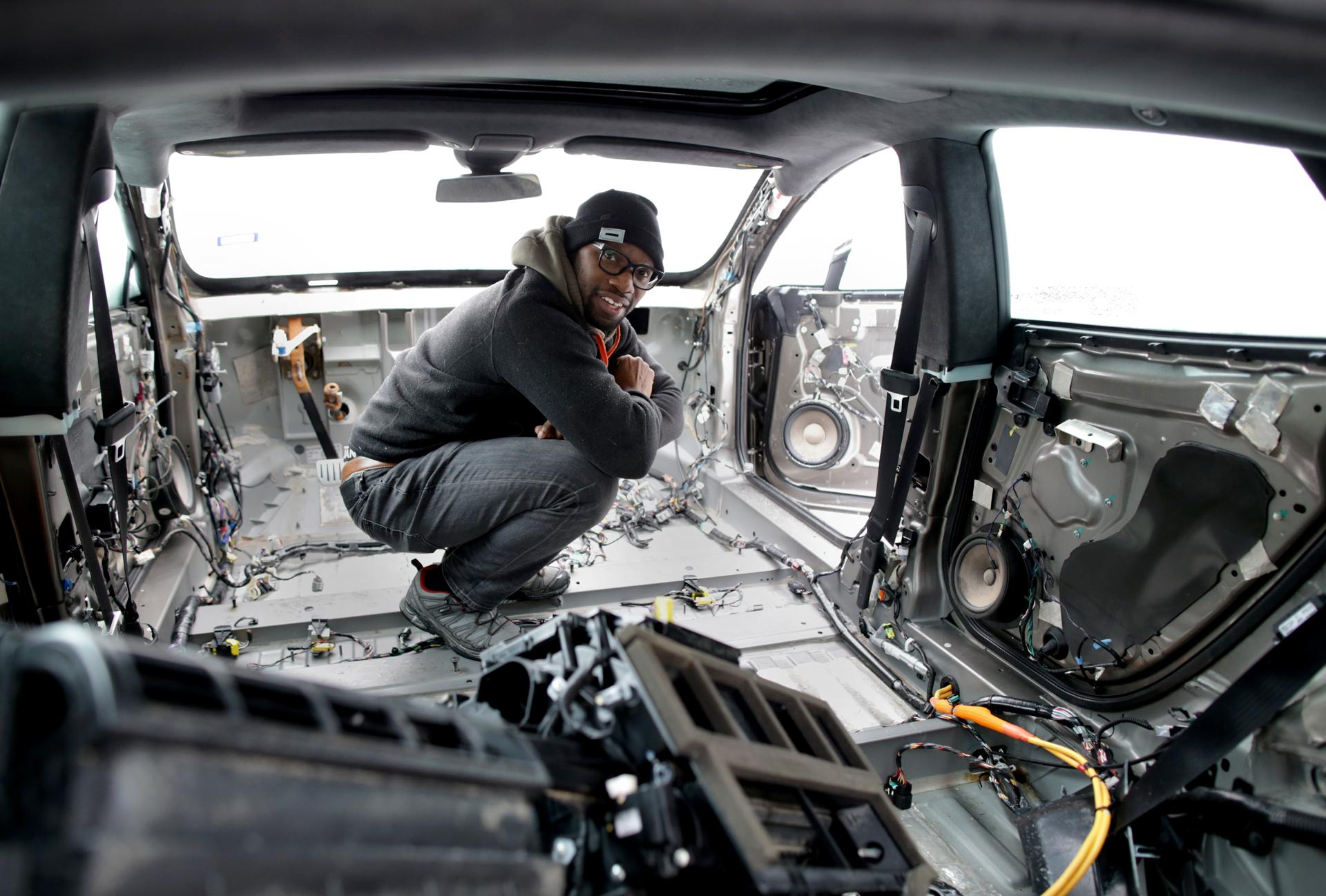 Rich Benoit inside one of the Teslas that he is in the process of refurbishing.