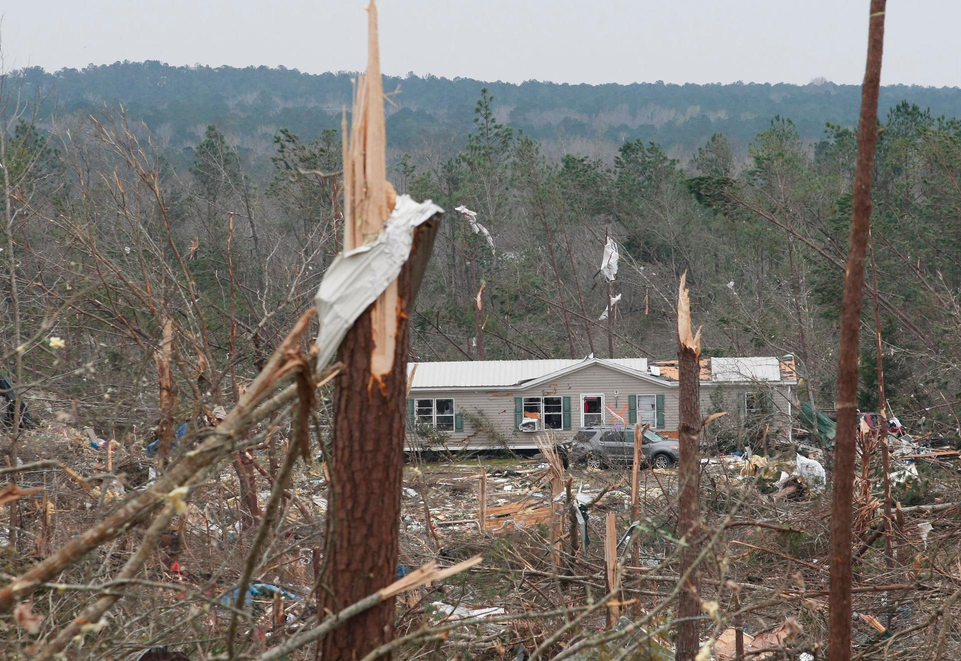 TOPSHOT - Damage is seen from a tornado which killed at least 23 people in Beauregard, Alabama on March 4, 2019. - Rescuers in Alabama were set to resume search operations Monday after at least two tornadoes killed 23 people, uprooted trees and caused