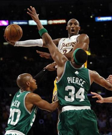Kobe Bryant goes over Ray Allen, left, and Paul Pierce during the fourth quarter.