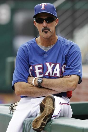 Texas Rangers pitching coach Mike Maddux watched batting practice.