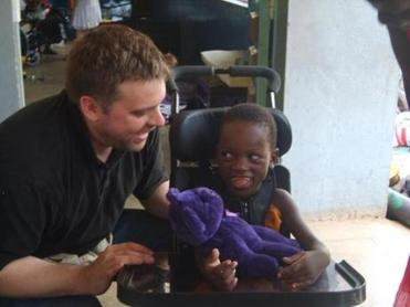 On a trip to Uganda in July, Dana passed along Ruth's wheelchair (and her favorite teddy bear) to a girl named Madrine.