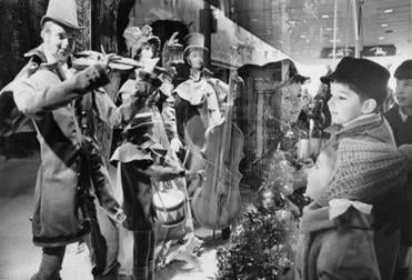 "12/13/1969 -- BOSTON -- BUSINESS -- THE WAY WE WORK -- GLOBE STAFF PHOTO BY FRANK WING -- ""Some things never change."" Robert and Patricia Mesko (ages 6 and 3 respectively) look in at the Christmas window display of Filene's in Downtown Crossing. The displays that year were entitled ""All Around Boston"", and featured scenes like this one of Louisburg Square. Library Tag 12192004 Business & Money -- Library Tag 11262005 Business 11departmentstore"