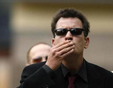 "Actor Charlie Sheen blows kisses towards fans as he arrives at the Pitkin County Courthouse in Aspen, Colorado in this August 2, 2010 file photo. Sheen plans to ""riff like an artist"" from memory rather than use a script on on his 21-date ""Torpedo of Truth"" tour next month, delivering a mostly spoken word performance of about 80 minutes, according to one of the show's producers. Joey Scoleri told E! News in an interview on March 18, 2011 that audiences would also get to ask questions of the fired ""Two and a Half Men"" actor, and he promised a ""wild ride of highs and lows and dark and light and laughter and being surprised."" REUTERS/Rick Wilking (UNITED STATES - Tags: ENTERTAINMENT) Library Tag 03232011"
