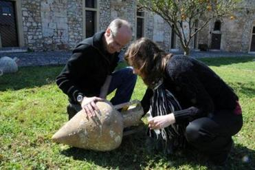Dr. Maria Hansson of Sweden's Lund University and Dr. Dimitris Kourkoumelis of Greece collect trace DNA from an amphora.