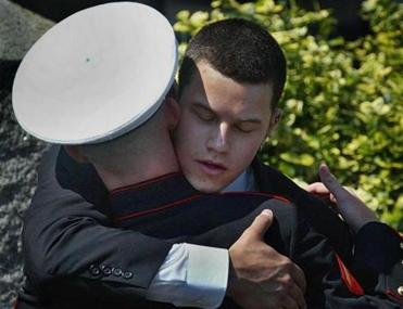 Brian greeted a Marine following funeral services for his older brother Alex, who died in Iraq, in September 2004.