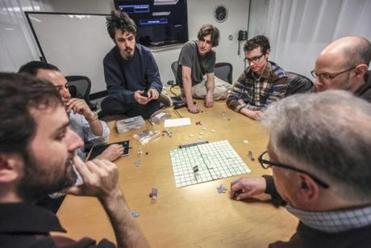 """Killer Croquet"" is play-tested during a board game design and prototype circle held at the Cambridge Innovation Center."