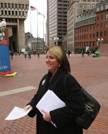 Caren Carew gave information sheets to passersby as union leaders pressed their case for higher pay for teachers.
