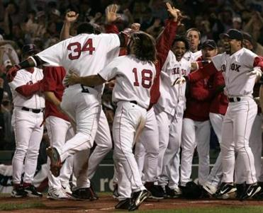 Ortiz was met by a mob of teammates at home plate.