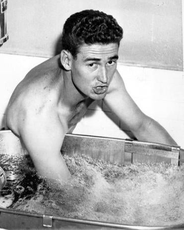 Ted Williams soaked his injured right elbow in a hydrotherapy tank.