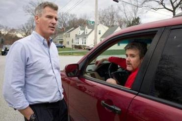 Senator Scott Brown stopped to talk to a motorist, Bill Flynn, as he campaigned in a Chelmsford neighborhood earlier this month. Brown is polling well among the state's independent voters.