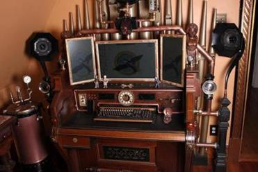 A circa-1880s pump organ has been updated to include a computer with a three-screen array, a webcam, scanner, and keyboard.