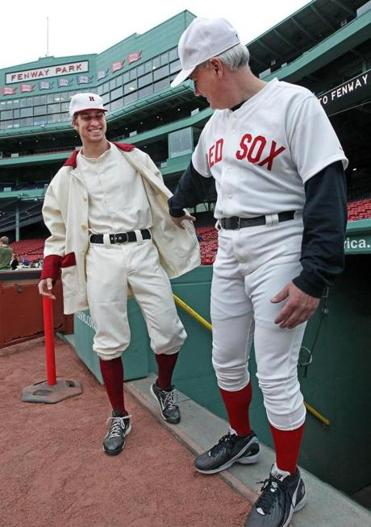 Harvard's Marcus Way (left) and former Harvard and Red Sox player Mike Stenhouse showed off vintage uniforms.
