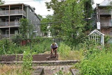The community garden on Coleman Street was built in the 1990s, a time of optimism in the neighborhood. But like many things built on hope here, it has fallen into decline.