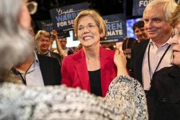 Elizabeth Warren greeted the crowd after winning the party nomination at the state Democratic convention at the MassMutual Center in Springfield.