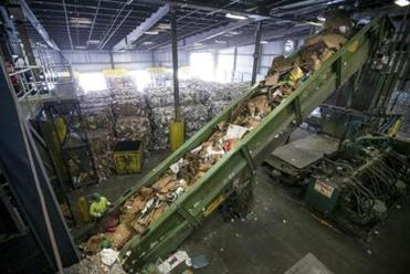 At Casella, cardboard is compressed into bales; paper from single-stream initiatives is notoriously contaminated with trash and other recyclables.