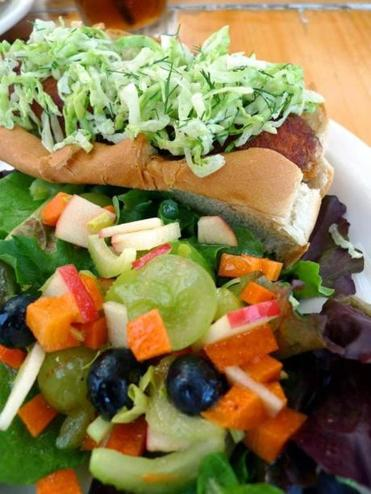 Tinys Local Food in Provincetown serves a delicious lobster hot dog on a bun topped with dill slaw.