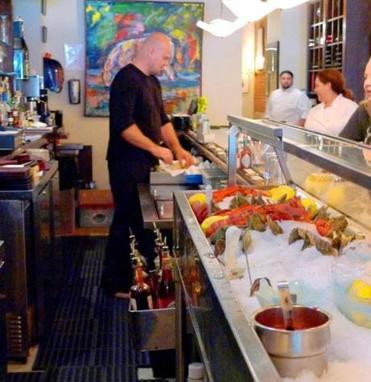 The raw bar is the main attraction at the Naked Oyster in Hyannis.