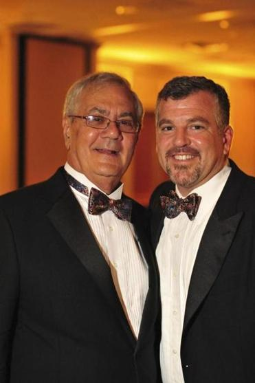 US Representative Barney Frank (left) and his partner James Ready posed during their wedding reception in this handout photo.
