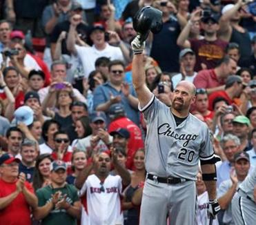 Former Red Sox and current White Sox Kevin Youkilis acknowledges the cheers of the Fenway Park crowd before his first at-bat Monday night.