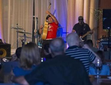 Jesse Copley, guitarist and lead vocalist with the Fall River band Day Old Funk, performed at Capiz Lounge in the Renaissance Hotel in South Boston in July.