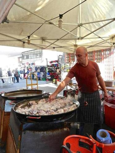 Nick Friedman in London preparing Valencian paella (it requires 25 pounds of chicken).