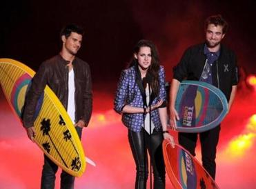 "Stewart with Robert Pattinson (right, along with their ""Twilight"" costar Taylor Lautner) in happier times."
