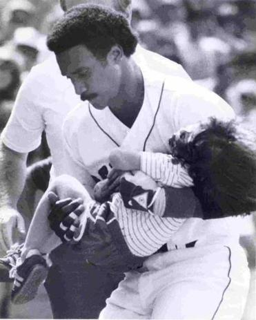 Jim Rice carried 4-year-old Jonathan Keane into Red Sox dugout after he was struck on the head by a Dave Stapleton line drive.