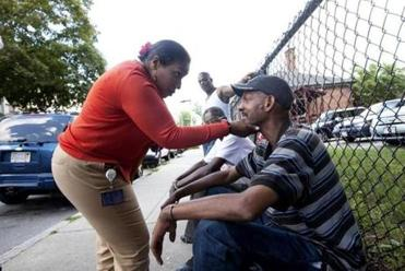 "Susan Young, a health center worker, visited homeless men on a patch of Olney Street known as ""the office."""