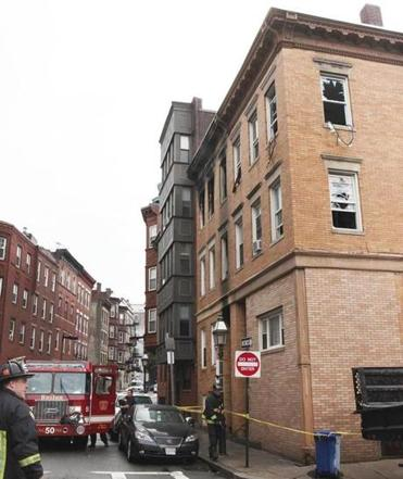 Fire officials are investigating the cause of a blaze that started in a four-story brick building in the North End Tuesday night. One woman was was seriously burned.