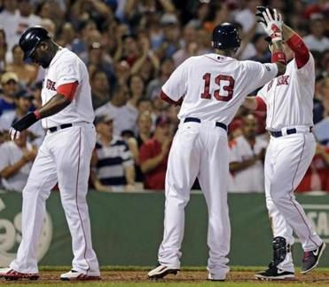 David Ortiz, left, was injured on this home run by Adrian Gonzalez.
