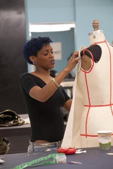 Sonjia Williams, a Lasell College graduate, working on one of her designs.