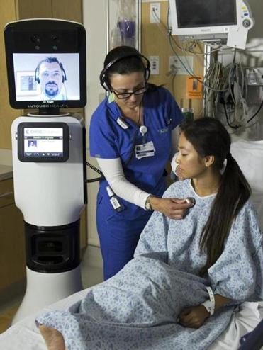 A doctor at another location checked on a patient using iRobot's RP-VITA device.