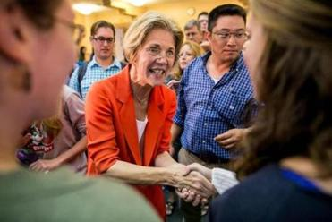 Elizabeth Warren greets attendees at a campaign event held on the campus of Boston University in September.