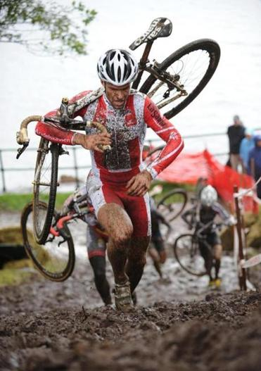Danish national cyclocross champion Joachim Parbo on the muddy run-up at Gloucester Gran Prix 2009.