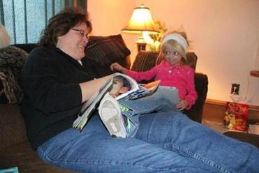 Megan Nighbor (right) read with her mom, Sandy, at their Dalton, Wisc., home.