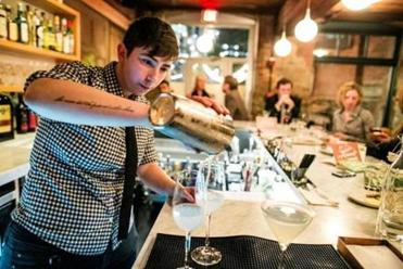 Bar Manager Fanny Katz pours a drink at Belly Wine Bar in Cambridge.
