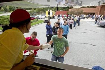 Vistaprint treats employees like Rick Keilty to free lunch from food trucks every other Wednesday.