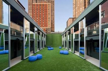 The AstroTurf-covered Great Lawn is one of three courtyards that lend light and air to the hotel and its surroundings, making The Out cool but not at the expense of hospitality.