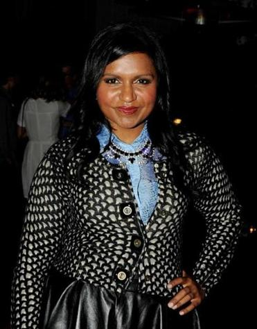 Mindy Kaling says she likes dressing up because it makes her happy.
