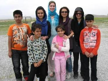 Brooke Loughrin (pictured in 2010 with an Iranian family) has lived in Iran and studied for a semester in India.